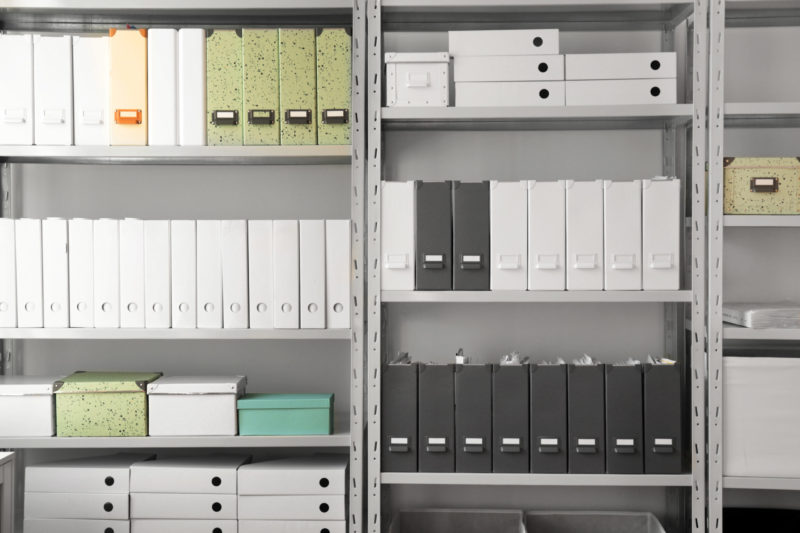 Office Organization Tip: Have designated areas for office items and supplies as shown by these shelves.