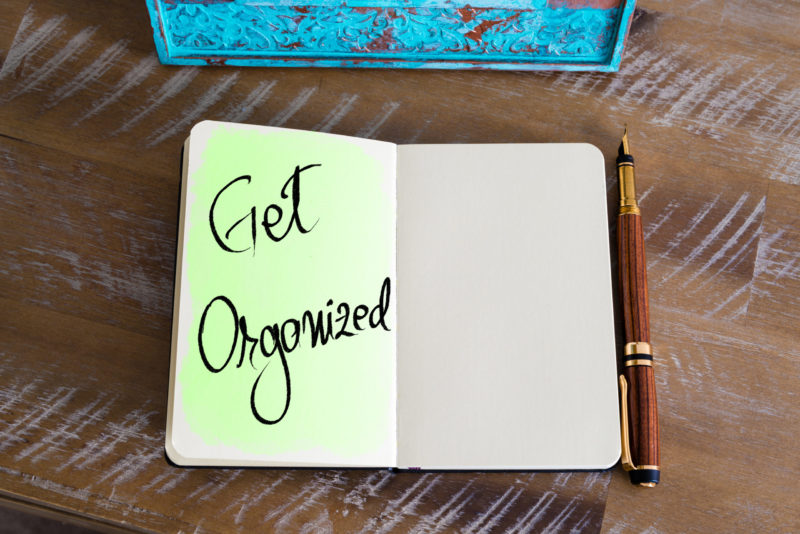 Office Organization Tips: Reminder to get organized in a notebook.